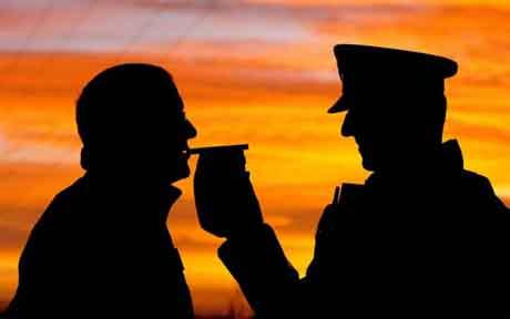 Christmas Drink Drive Campaign...Library file photo dated Thursday 30 November, 2006, of a motorist stopped by police giving a breath test as the Christmas Drink Drive campaign is launched near Doncaster today. PA Archive